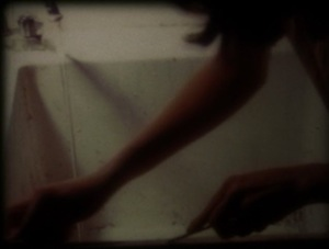 "Still from ""Restoring Appearance to Order in 12 Min."" (16mm) by Coleen Fitzgibbon"